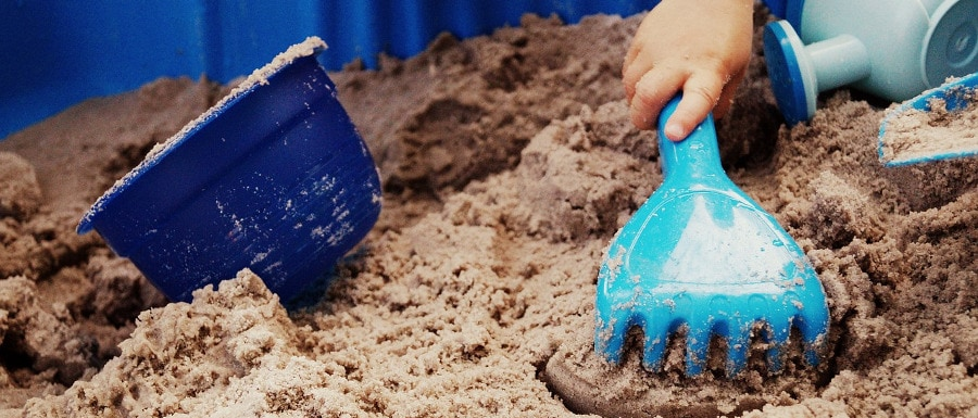 creative play for children using sand, rakes and buckets