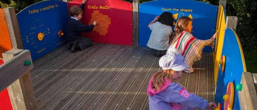 children using interactive play equipment in a Yorkshire playground