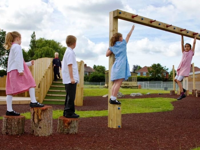 children using adventure playground equipment