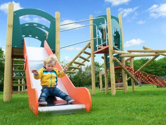 child using play park equipment