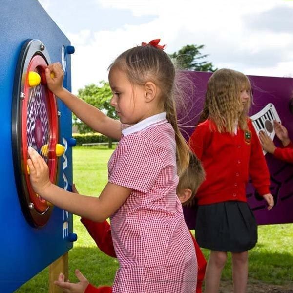 girls using educational playground equipment