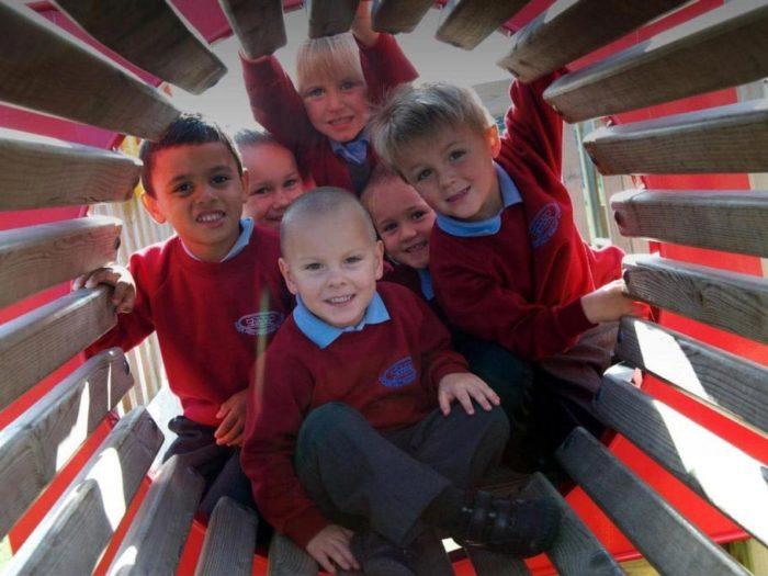 children inside a playground tunnel
