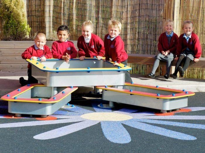 children enjoying water playground equipment