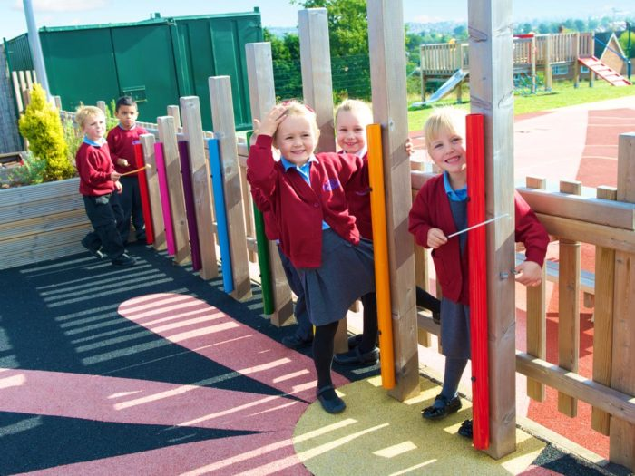 Glade Hill Primary School children on their natural playground equipment