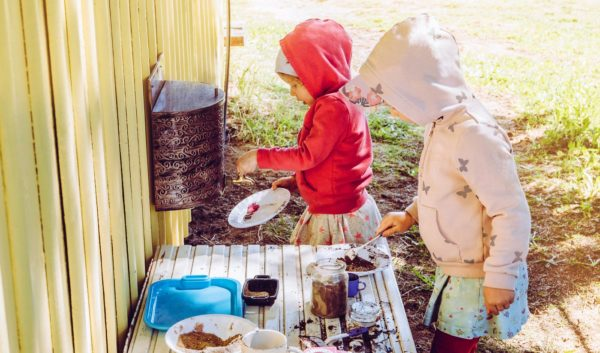 children using an outdoor mud kitchen