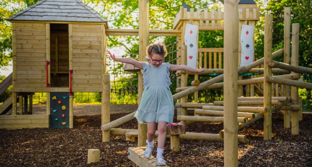 girl enjoying bespoke playground equipment
