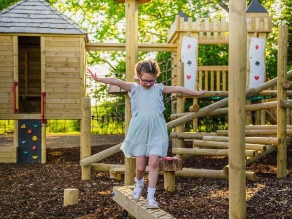 child using a balance beam on Rockcliffe Hall Hotel's bespoke playground