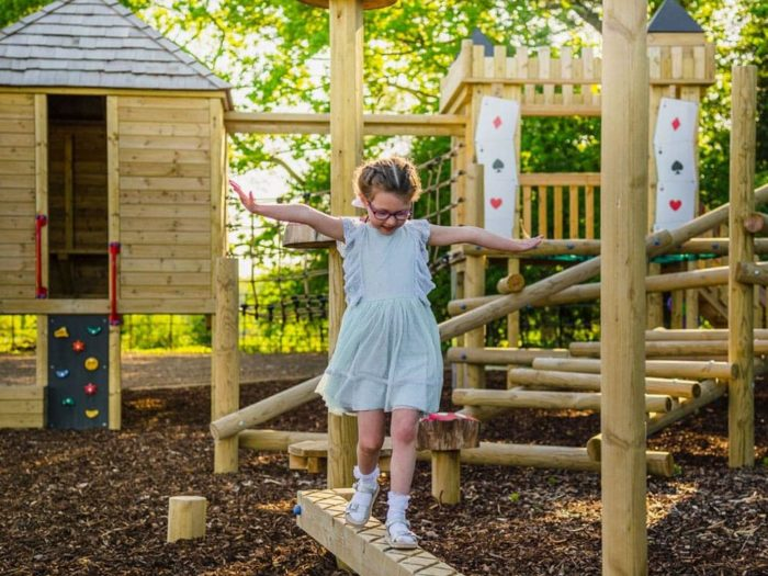 child using a balance beam on Rockcliffe Hall Hotel's bespoke playground