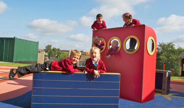 children using a playground boat role play equipment