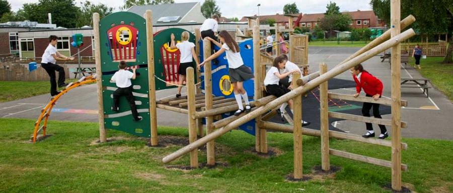 children on a playground tower system