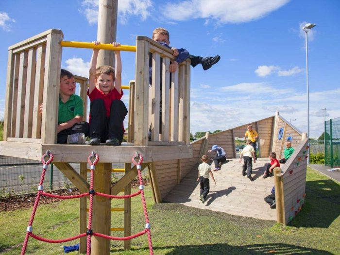 children playing on bespoke climbing tower at Morpeth Road Primary School