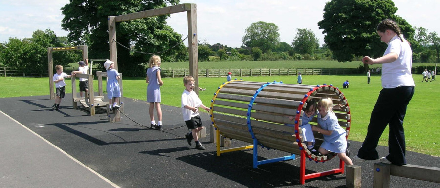 children using a playground tunnel for social play