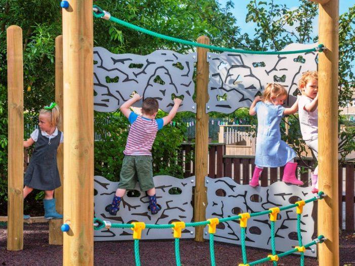 Children using climbing equipment at Colburn Primary School