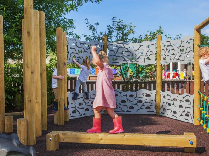 child using new outdoor trim trail equipment at Colburn Primary School