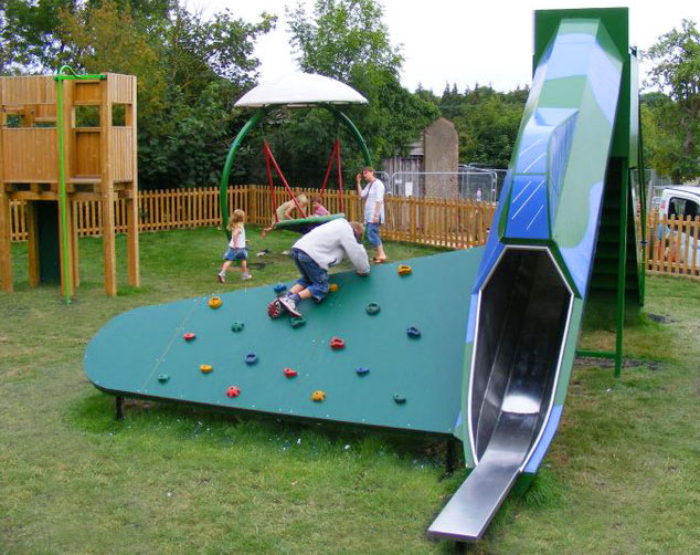 bespoke park playground design with aeroplane slide and climbing wall