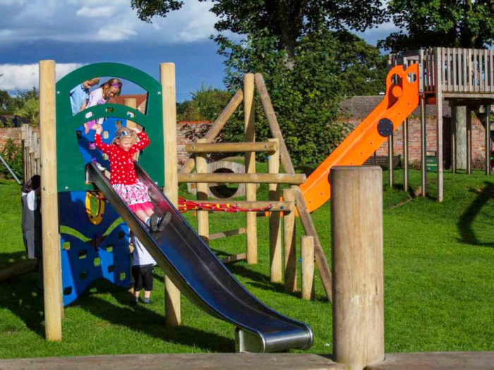 children enjoying Easingwold Memorial Park playground equipment