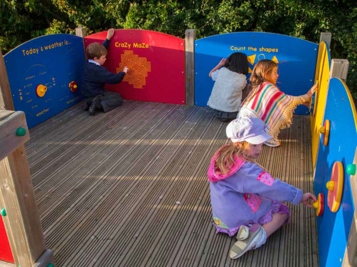 children using playground discovery boards