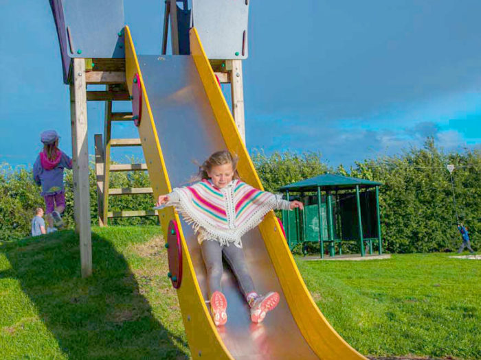 girl using playground slide