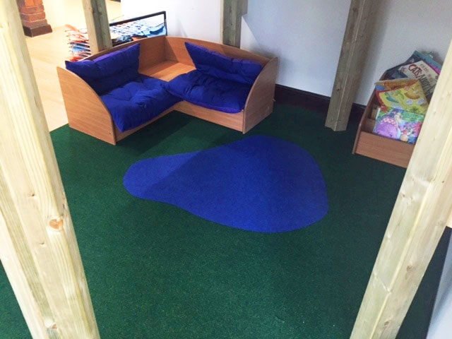 seating and carpet in Rush Green School's reading room
