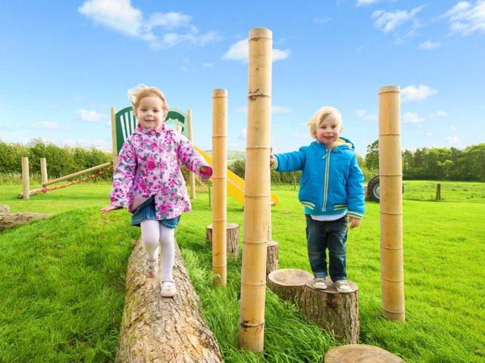 children running on parish council playground equipment