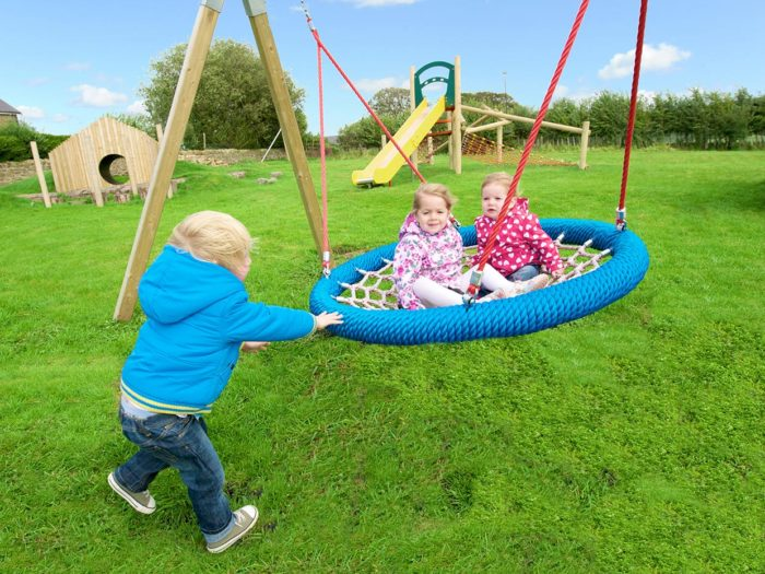 children playing on a basket swing