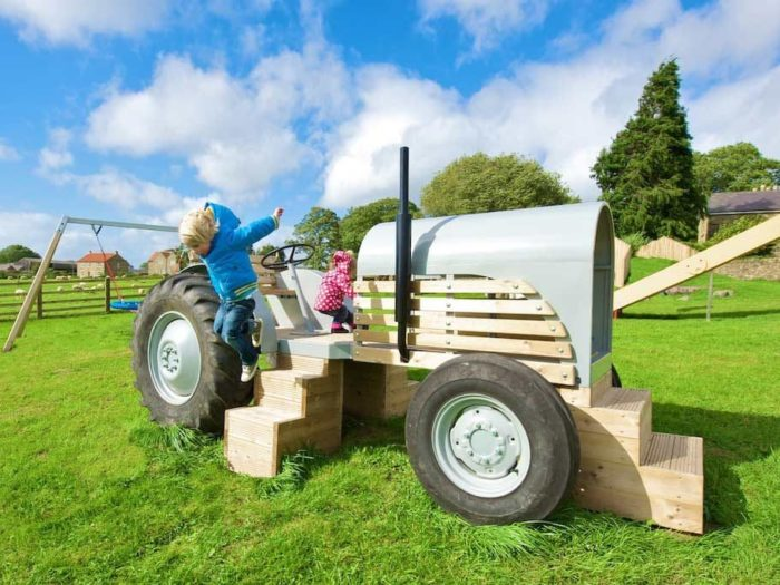 children playing on a playground tractor