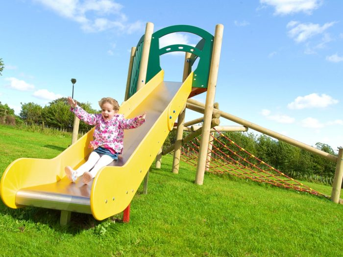 young girl on Nether Silton playground slide