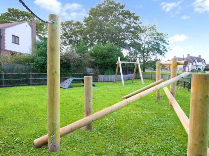 wooden adventure trail in village playground design