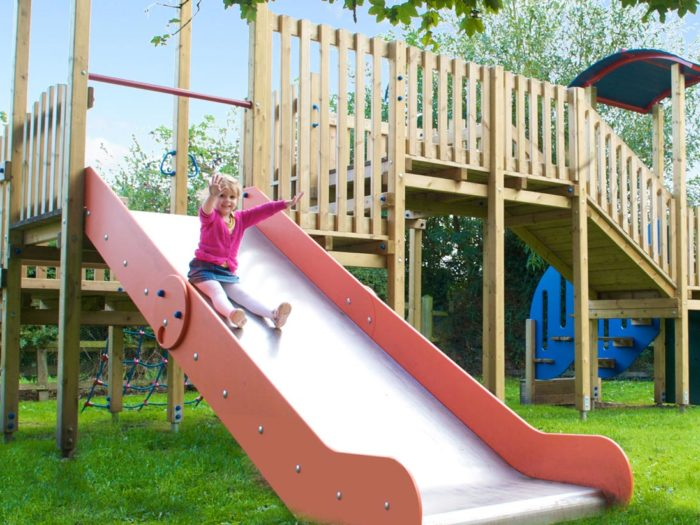 girl enjoying the new slide at Pickhill Parish Council village playground