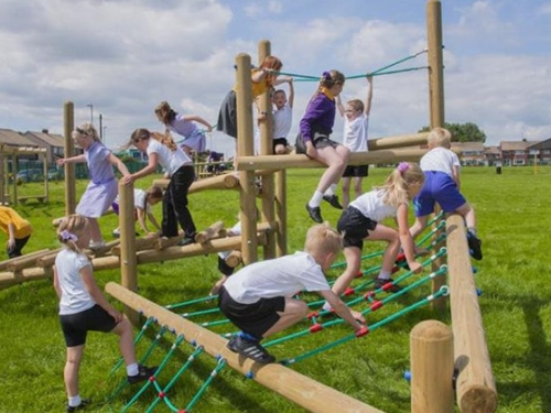 children climbing over equipment