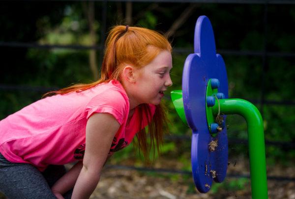 girl using bespoke playground equipment