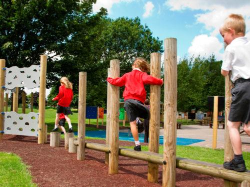 children enjoying new playground equipment trails