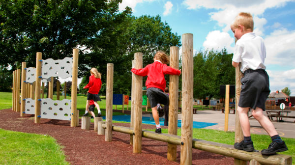 Trim trail - children enjoying new playground equipment trails