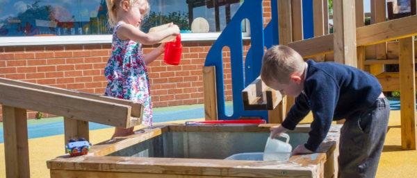 children enjoying new water playground equipment