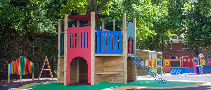 playground climbing frame around a tree