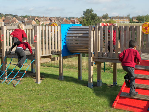 school children enjoying their new playground climbing frame and activity centre
