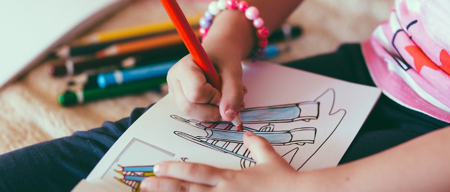 child colouring and doing indoor play activities