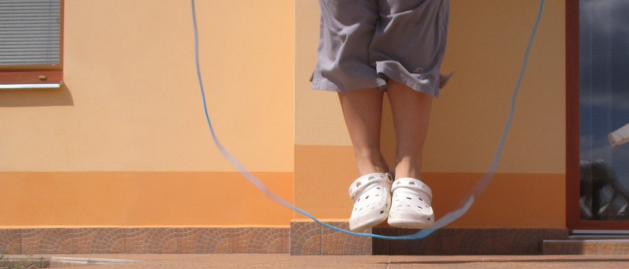 child skipping as part of a home obstacle course