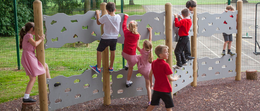 children problem solving through play on a traverse wall