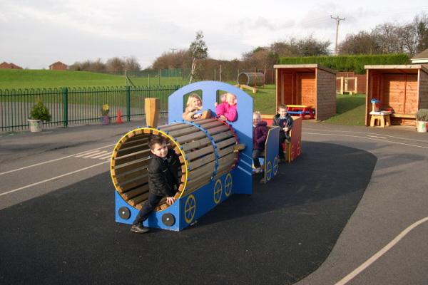 children enjoying imaginary play on a role play train