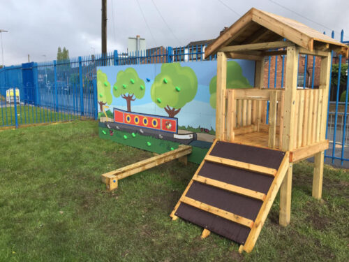 colourful climbing EYFS playground design with trees