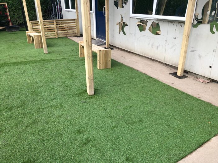 artificial grass under inclusive playground canopy