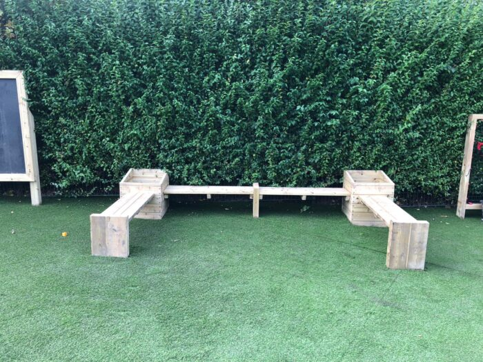 image playground planters with artificial grass at a school