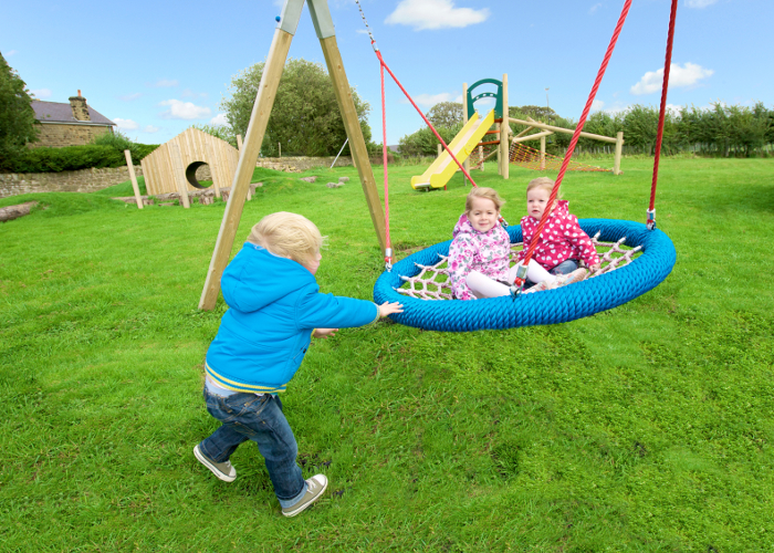 children playing with a basket swing