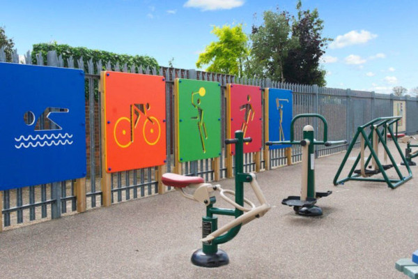 playground signs and exercise equipment