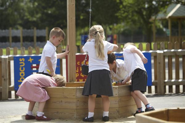 children playing in a sandbox