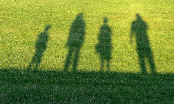 family shadow on grass