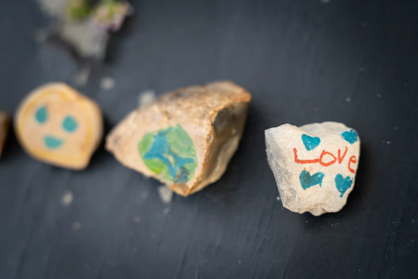 decorated pebbles as summer playground activity