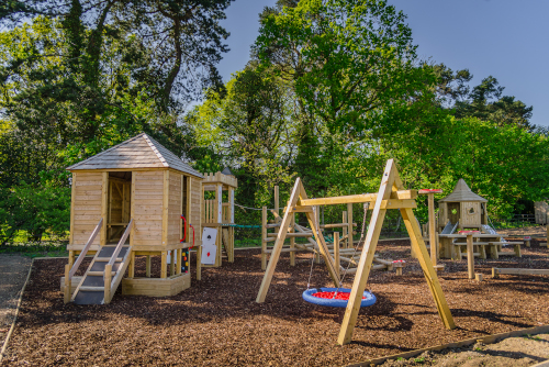 bespoke playground design with bucket swing and climbing system