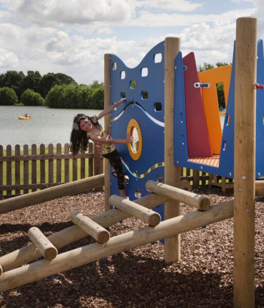 child using stately home playground equipment